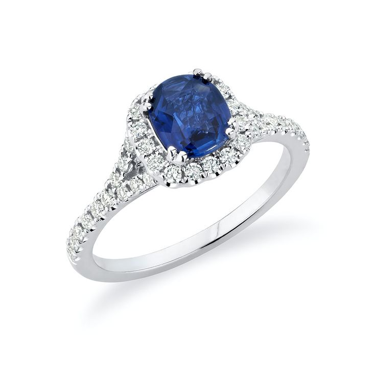 Blue sapphire and diamond engagement ring in 18K white gold.