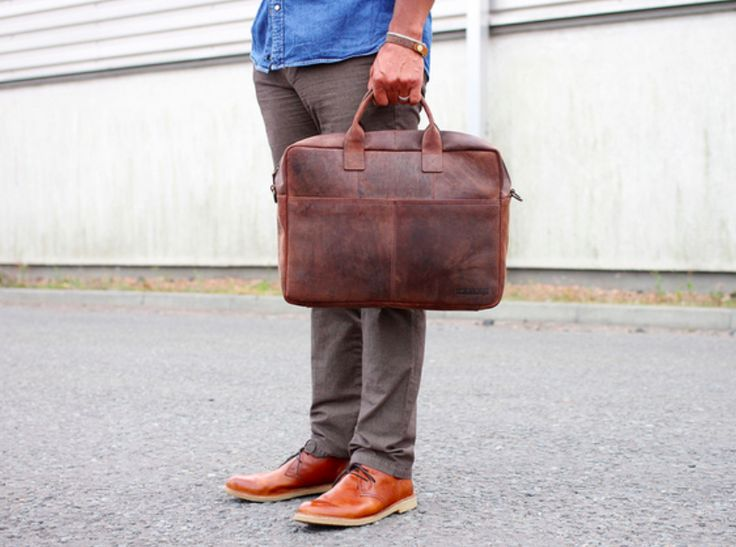 This leather laptop bag will accompany you from the office to home in style and function. The large zippered body will easily hold files, folders and notebooks, alongside a separate interior section that is padded to securely hold your laptop. #vintage #leatherbag #giftsforhim
