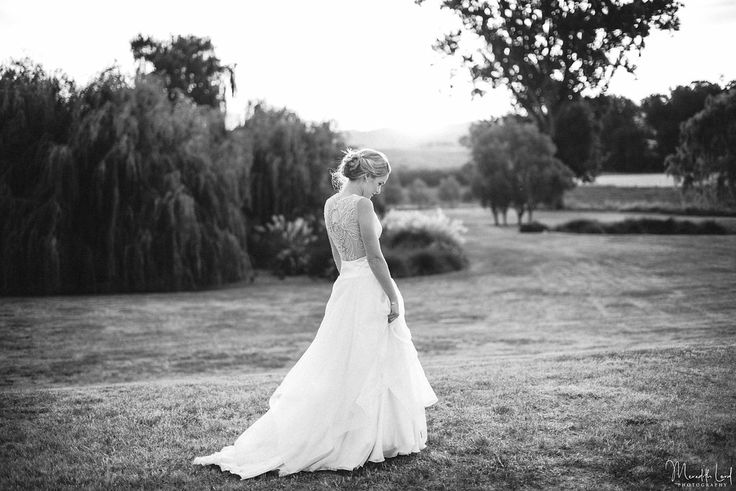 Melody wears the stunning sheer back wedding dress hand-crafted from layers of  fine chiffon and silk organza. The hand-beaded back is truly spectacular. #romanticweddingdress #layeredskirt #softandprettygown