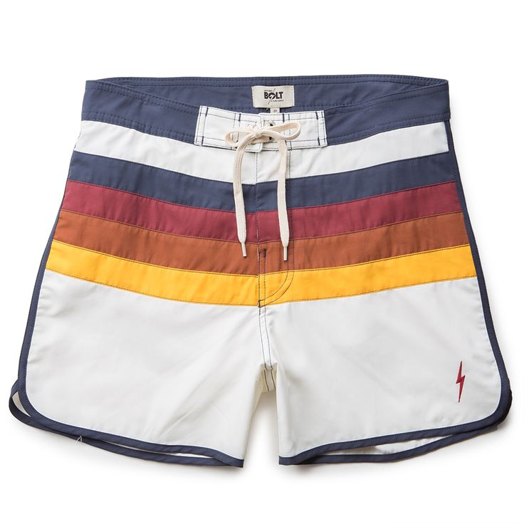 """The Lightning Bolt Uber Alles Men's Boardshorts in the Egret Colorway are a scallop leg boardie with color insets and contrast trims. They have a velcro fly and a back pocket at the right side with flap and velcro closure. Lightning Bolt embroidered logo at bottom left. 16"""" Outseam. Made of 51% Cotton/49% Polyester. Machine wash cold/Dry flat."""