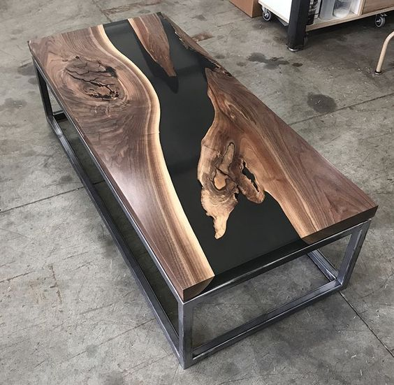 awesome wood table i wonder was resin used to fill in the gap us  essentially all of the black in the table 4e27c97f1