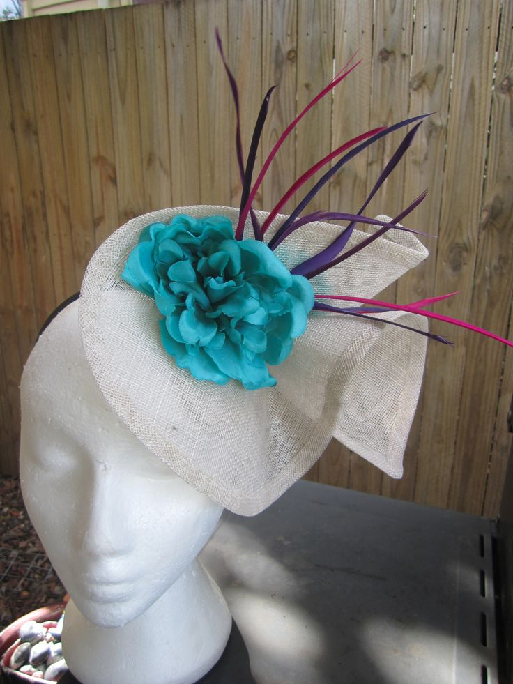 Cream sinamay fascintor with teal, purple and pink highlights