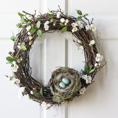 A richly beautiful egg and nest filled Easter wreath.