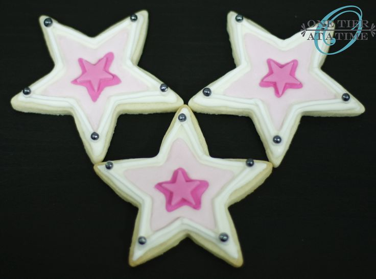 American Girl star sugar cookies with royal icing and fondant star accents