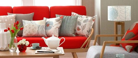 Great visual. Notice various pillows - sizes, prints, all complementing the bold amount of red.