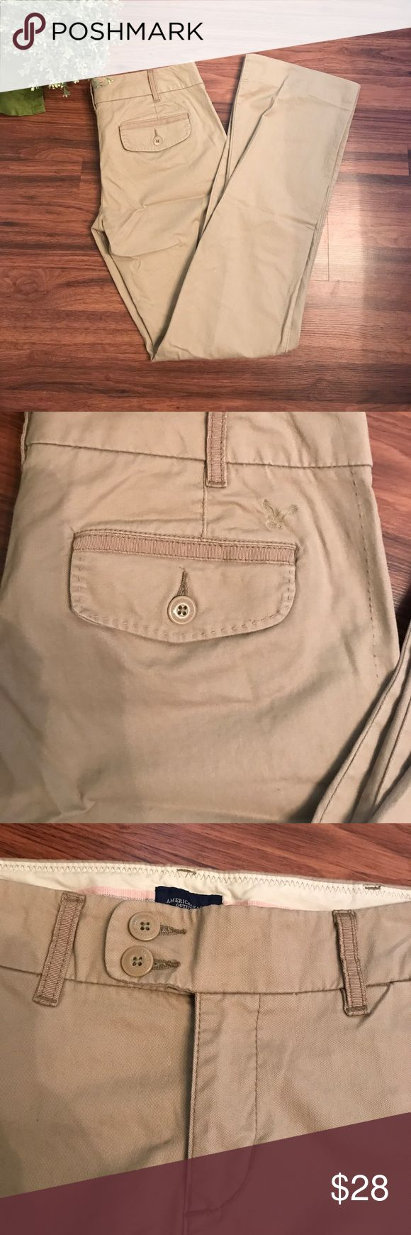 AE khaki chinos Trouser leg. Classic khaki color. Cute polka dot lining. Size 6Long. Excellent condition! American Eagle Outfitters Pants Trousers