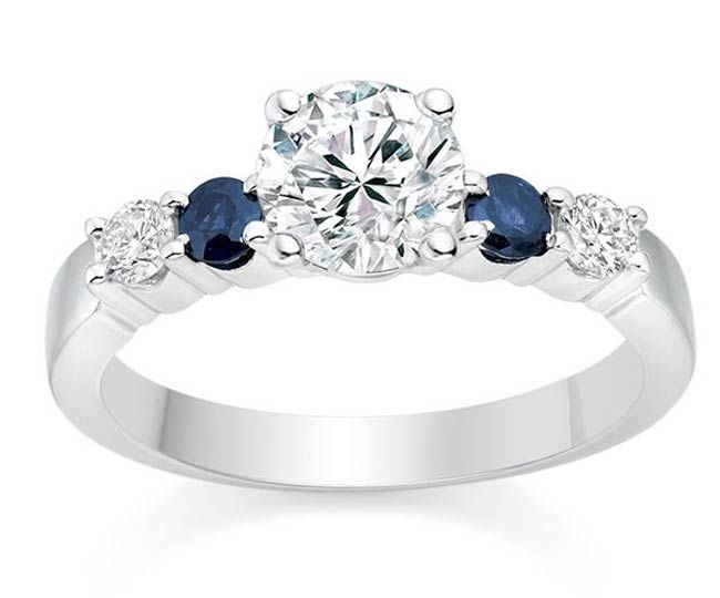 Diamond and sapphire engagement ring                              …