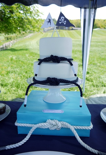 2 Tier Vanilla and lemon buttercream cake topped with Swallows and Amazons flags.