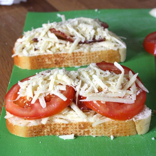 Garlic-rubbed Grilled Cheese With Bacon And Tomatoes With Bacon, Grated Gruyère Cheese, Fontina, Parmigiano Reggiano Cheese, Crushed Red Pepper Flakes, Italian Bread, Tomatoes, Butter, Garlic