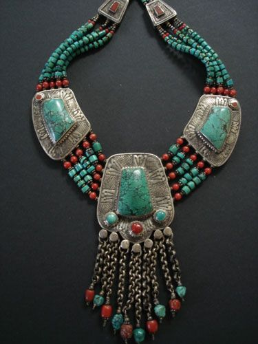 Contemporary Tibetan Turquoise Necklace. The centre pendant has ten chain dangles with coral & turquoise. Five strands of turquoise beads graduate in size with brass, silver and coral beads: