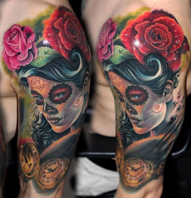 Colorful sugar skull tattoo on arm