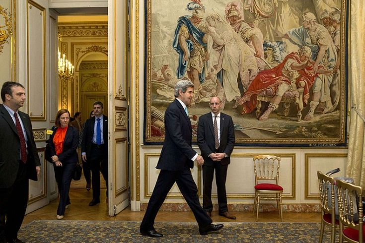 US Secretary of State John Kerry (C) followed by State Department Spokesperson Jen Psaki (2nd L) arrives for a news conference at the U.S. Ambassador to France's residence in Paris, following his meeting with Russian Foreign Minister Sergey Lavrov about the situation in Ukraine.