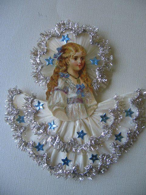 Vintage Look Victorian Christmas Ornament -German Scrap Girl With Crepe Paper Skirt German Dresdens, Spun Glass Halo, Fringe Tinsel. $18.00, via Etsy.