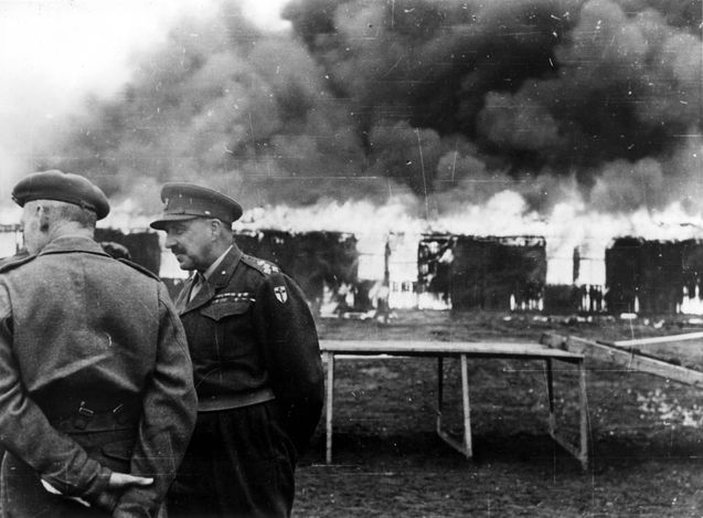 Bergen Belsen, Germany, General Glyn Hughes watching the camp burning, after liberation, May 1945.