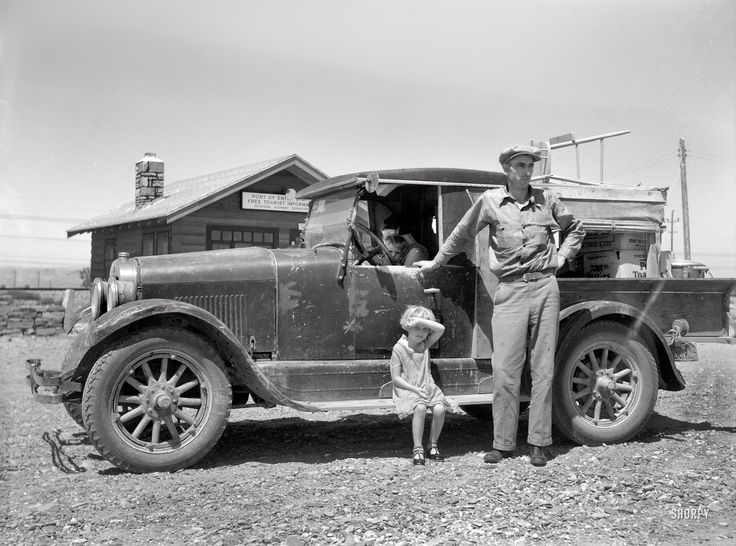 """July 1936. """"Drought refugees. North Dakota farm family moving to Idaho at port of entry near Miles City, Montana."""" Medium-format nitrate negative by Arthur Rothstein for the Resettlement Administration."""