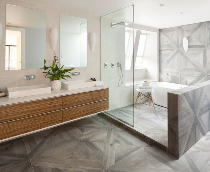 Photo Of Beautiful modern bathroom with enclosed shower and floating vanity