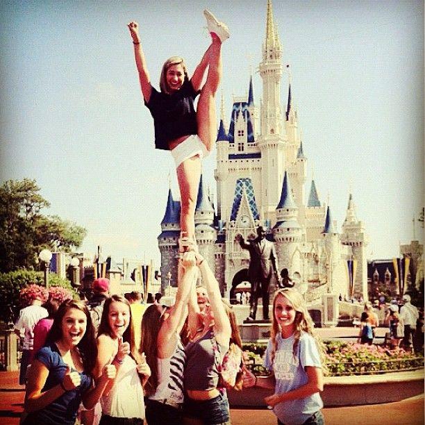 Heel stretch cheer stunt in front of Cinderella's castle at Disney World!