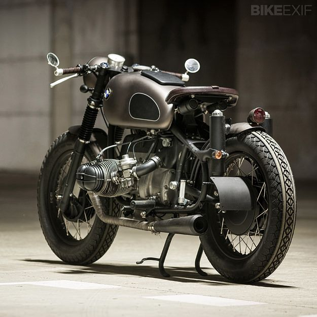 ER Motorcycles BMW R80 'Mobster' by Blaž Šuštaršič and his team at ER Motorcycles.  Appropriately dubbed 'Mobster', this brooding bobber consists of an '84 R80 engine in a R69S frame, with R50/5 forks and a rare Schorsch Meier fuel tank. The colour scheme is a blend of metallic bronze and black, with hints of raw and polished metal. There's also some impressive leather work on the grips and seat. The bike's overall stance is flawless: menacing, yet begging to be ridden. [ER Motorcycles]