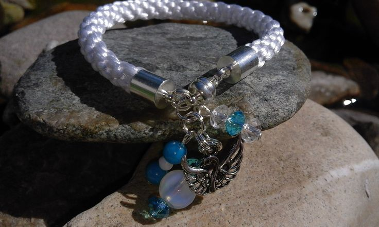 White kumihimo bracelet with blue and white beads, and a silver swan. It reminds me of summer. ♥