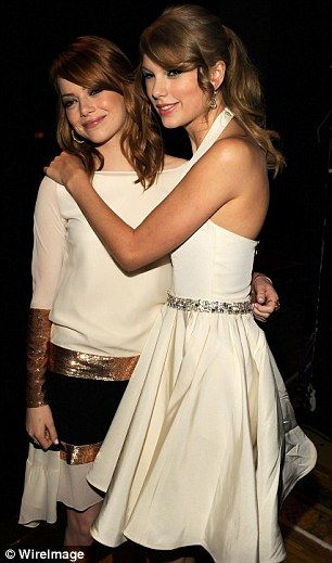Gal pals: Taylor pictured with famous friends Emma Stone