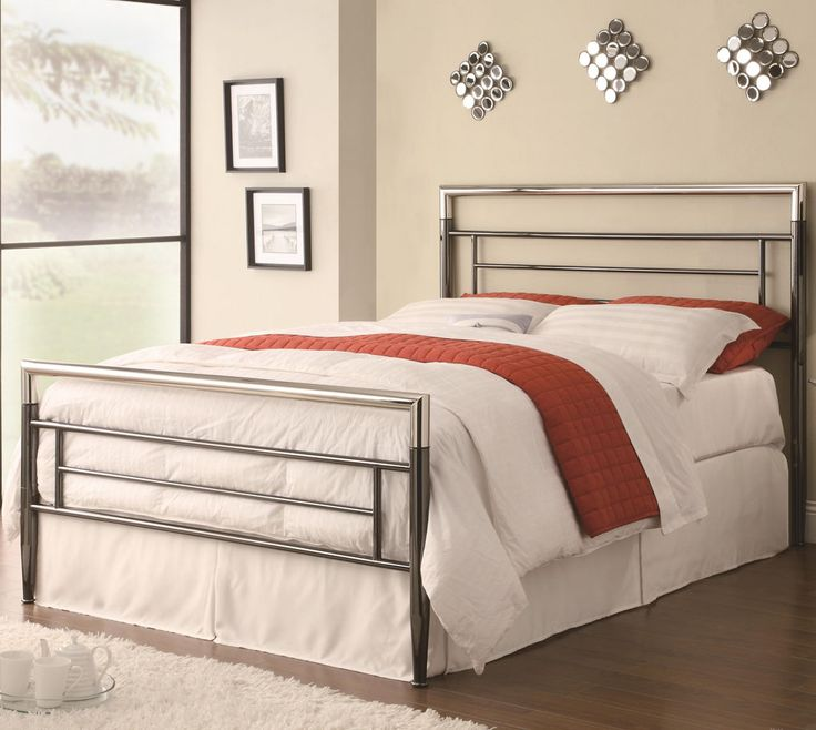 queen bed using metal headboard and there are two white pillows
