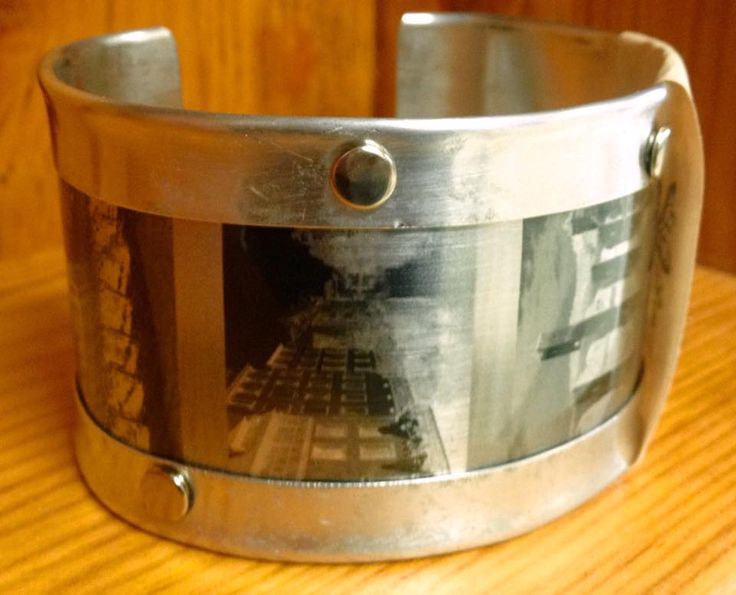 Hand made aluminum cuff with vintage style photographs.  $27 From www.facebook.com/stashbug