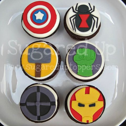 Avengers Fondant Cupcake Toppers  Inspired by the hit movie and classic comics, these cupcake toppers will be a show stopper at your next event.   Includes 12 fondant toppers, 2 of each shown. ($25)   Toppers measure approximately 2.5 inches across, perfect for standard sized cupcakes.   Colors are fully customizable!