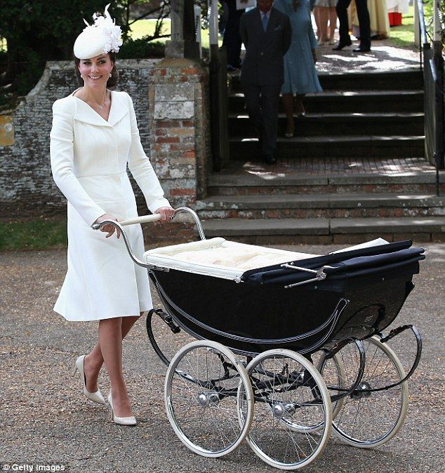 Kate, dressed all in white, pushed Charlotte in the coach-built  pram made by Millson