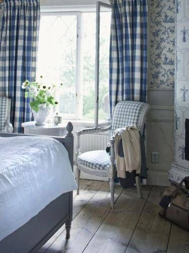 Blue, white and grey Scandanavian/Swedish style bedroom with check/checked/gingham curtains -- Wreta Gestgifveri Hotel, Sweden