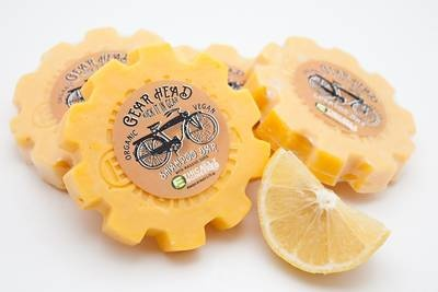 Round label on soap in the shape of a bicycle gear that turns into shampoo.  It's also ecofriendly.