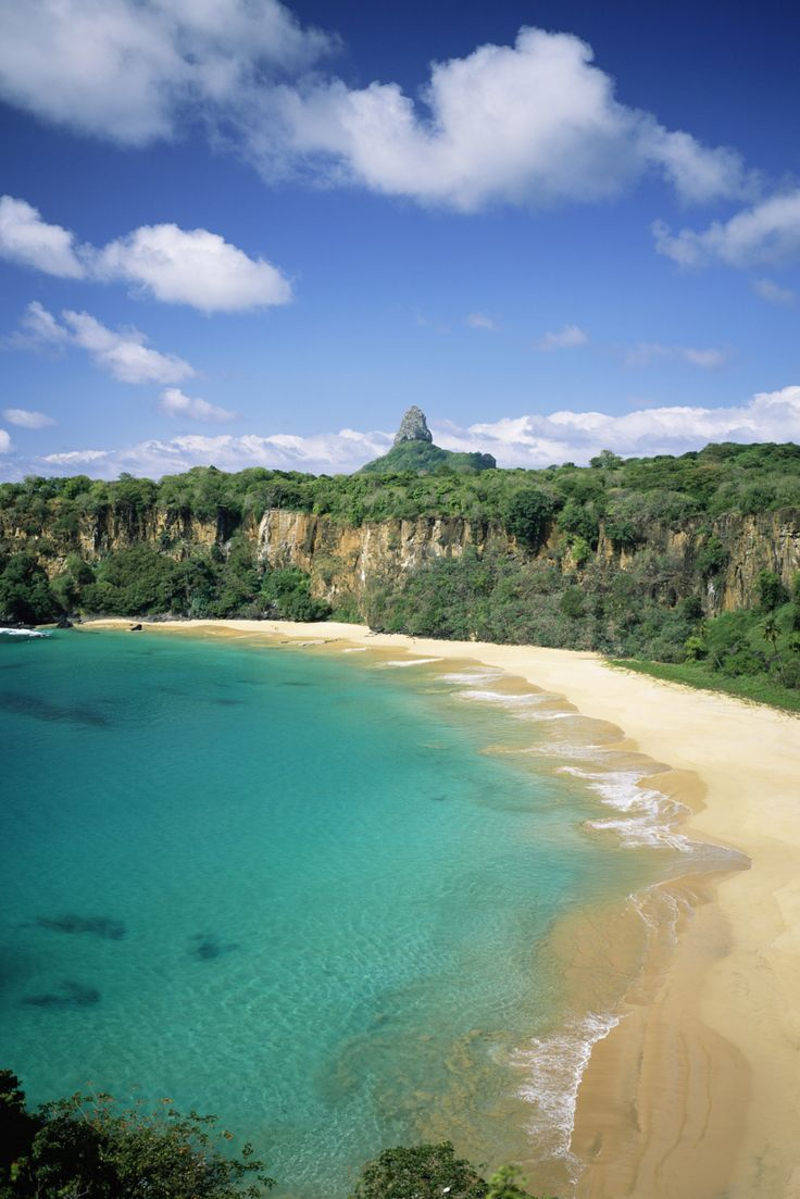 Located 200 miles off Brazil's coast on Fernando de Noronha island, Baia do Sancho is only accessible via boat or by hiking down a narrow staircase from surrounding cliffs making it secluded and virtually untouched.