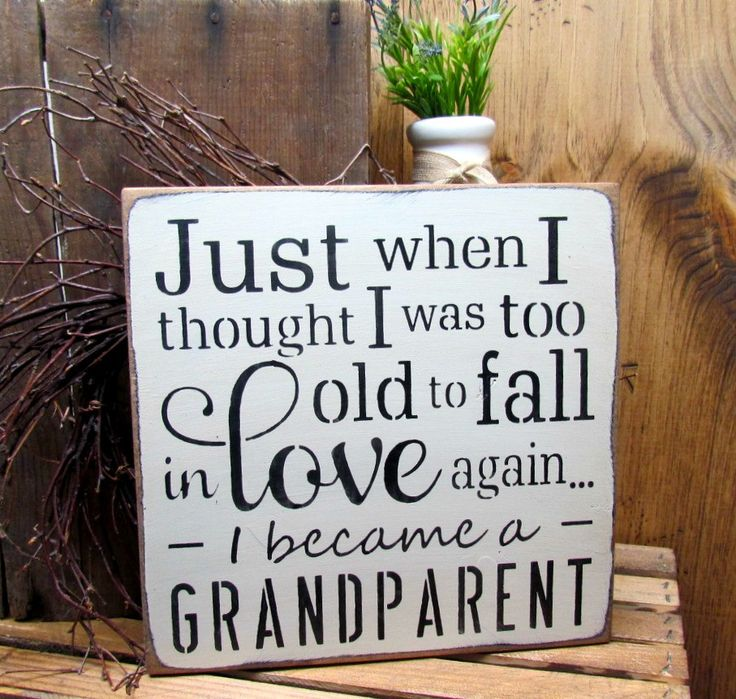 "This wooden sign reads ""Just When I Thought I Was Too Old To Fall In Love Again I Became A Grandparent"" It measures 11 1/4"" X 11 1/4"" Hand painted Craft White with black lettering, sanded, stained and"