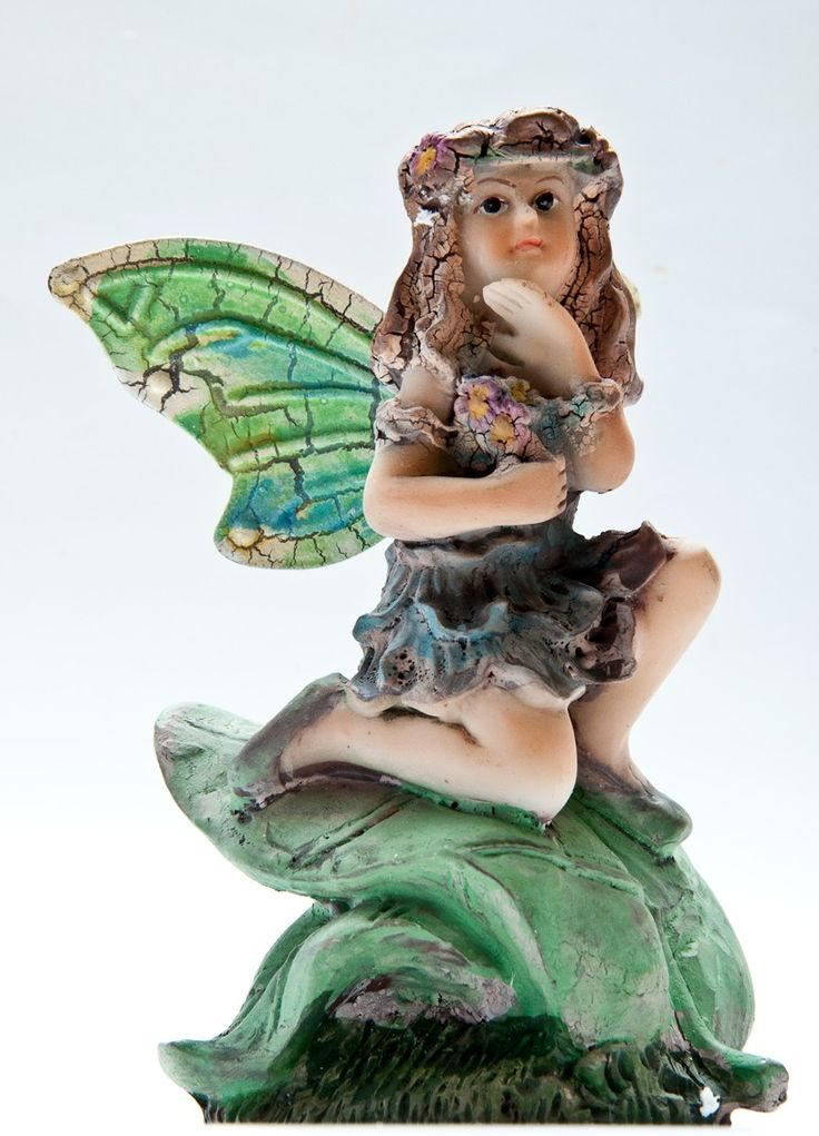 Fairy with hand under her chin
