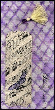 Bookmark made with vintage sheet music - scrapbook paper would work, too.  Laminate for wedding favors? - Cloth Paper Scissors