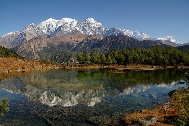 Annapurna Range reflected in Sekong Lake, Nepal (by Rejselyst).