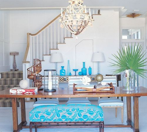 Suzanne Kasler Watersound showcase.  White dining with punches of turquoise.  Ottoman dining bench.