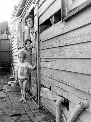 April 1977: Elizabeth Thompson with her two children, Paul and Jane, who lived in the Thompson St, Kensington, described by the Tenants' Union as one of the worst houses they'd ever seen.