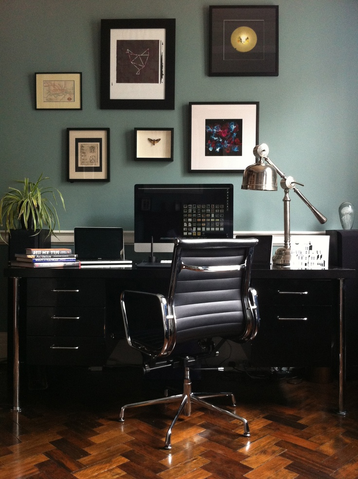 I love working from home. I bought this desk from an auction at Lots Road for only 250. It's 1960s ebonized teak. Beautiful chrome legs and the internal joints are all dove tailed. The Eames is only a cheap repro so Sssh. The colour is Oval Room Blue from Farrow & Ball. 2 of the art pieces are by friends and 1 is by me and you can see one of my Horrorgami pieces on the right.