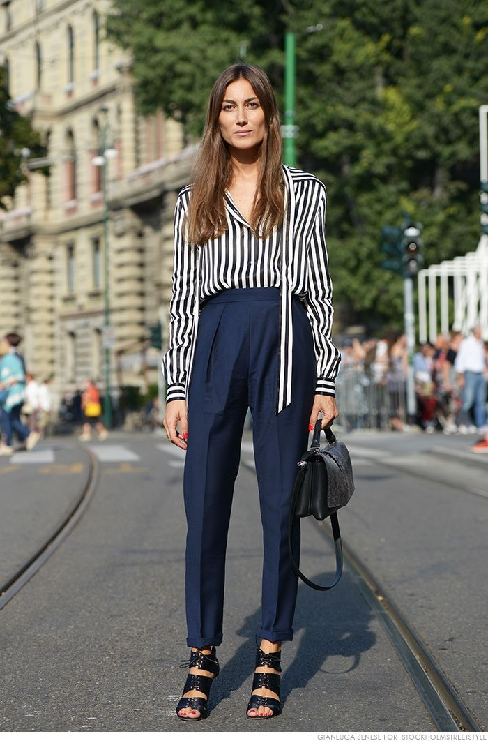 GIORGIA TORDINI in navy blue striped button shirt, loose trousers, strap sandal heels