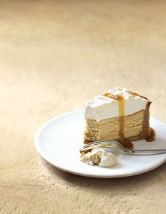 salted caramel and vanilla baked cheesecake       500g plain sweet shortbread biscuits       ½ cup (60g) almond meal (ground almonds)       150g butter, melted       350g ricotta       500g cream cheese       1 cup (175g) brown sugar       4 eggs       2 tablespoons golden syrup       ¼ teaspoon table salt       2 teaspoons vanilla extract       1 cup (250ml) single (pouring) cream       1 cup (240g) sour cream       1 tablespoon icing (confectioner's) sugar, sifted       sea