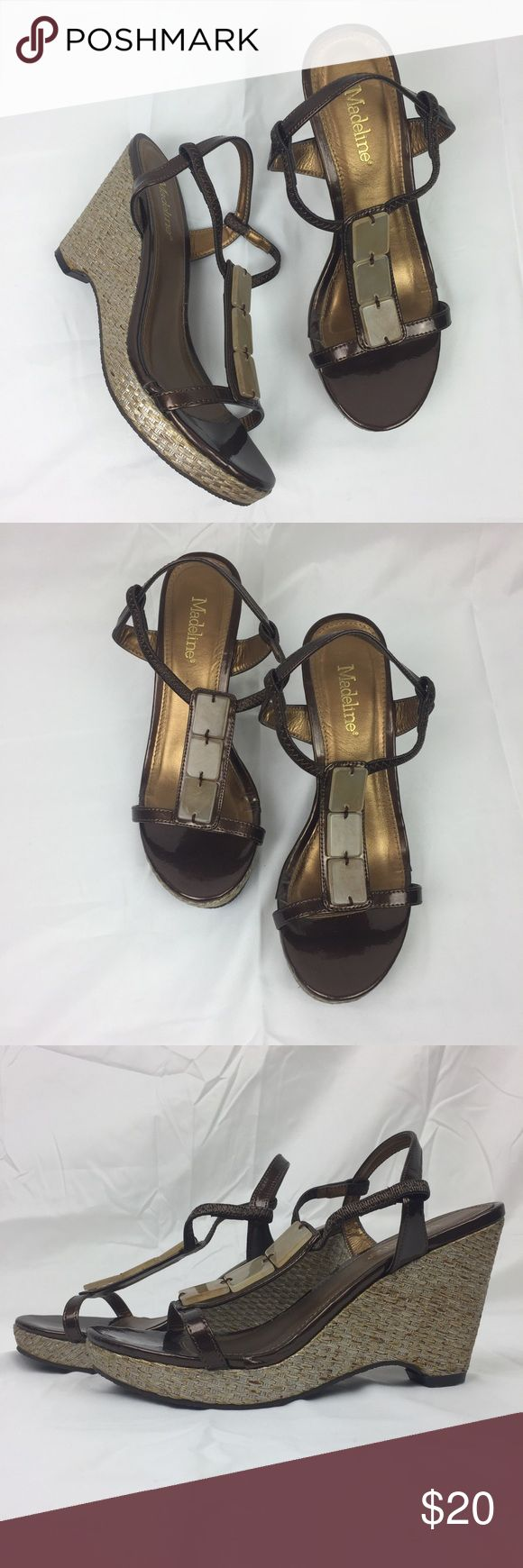 """Neutral wedge sandals Neutral wedge sandals. ~3.7"""" heel. Dark brown straps with neutral colored wedge. Wedge features woven detailing. Embellishment on foot. VGUC with minor wear on the heel of the sole. Madeline Shoes Wedges"""