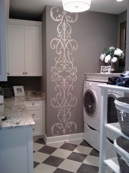 My Sister & I, Inc vertically stenciled an enlarged Modello® Designs Architectural Border (AchBor103) on a wall! More laundry room inspiration after the link jump.