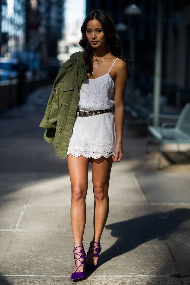 Jamie Chung wears a lace mini dress, skinny belt, army jacket, and lace-up heels