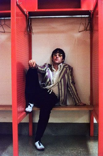John Lennon relaxes backstage at Shea Stadium on August 24, 1966.