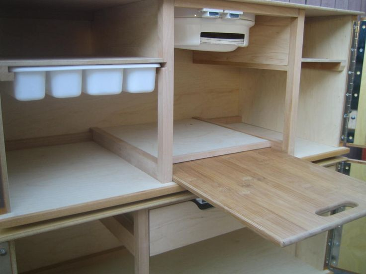 "camper kitchen | Timberline Camp Kitchens | Organized Camping for the Outdoors~ I like the silverware divider ""drawer"" and the paperplate dispenser! This is a great design. It would make it lighter than the one I made with all wooden drawers.:)"