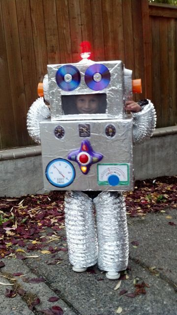 DIY Robot -tinfoil, CD's, game piece, and a head lamp