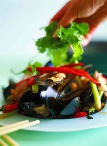 We cook at lot of Kylie Kwong's recipes, she has some great recipes with mussels  This is stir fried mussels with black bean sauce