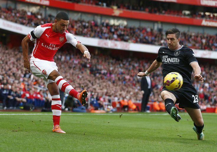 Alex Oxlade-Chamberlain is closed down by Burnley's Stephen Ward
