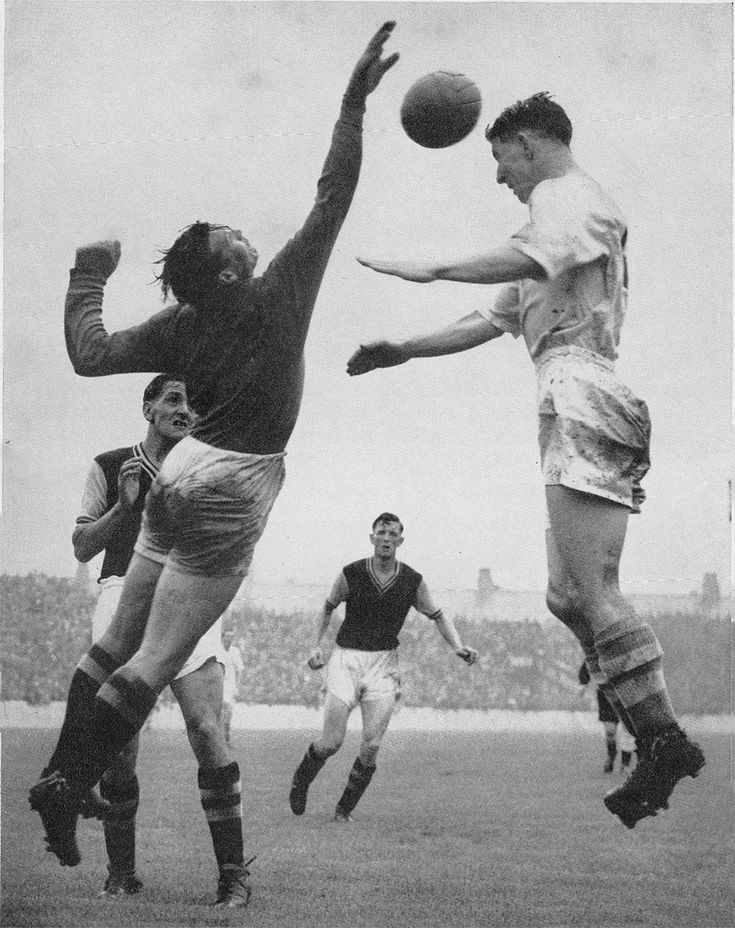 25th August 1956. Aston Villa goalkeeper Nigel Sims challenging Manchester City winger Roy Clarke, at Maine Road.