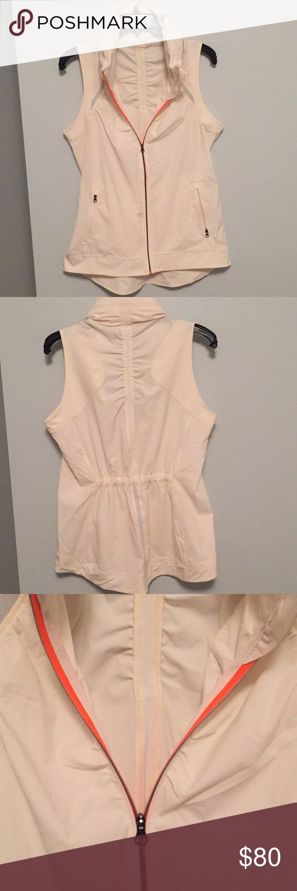 NWOT Lululemon Vest NWOT Vest from Lululemon. Pink and silver reflective details make this Vest great for running or biking! Zipper in collar can be undone to reveal an optional hood. Size tag removed, fits LIKE AN 8 OR 10! lululemon athletica Jackets & Coats Vests